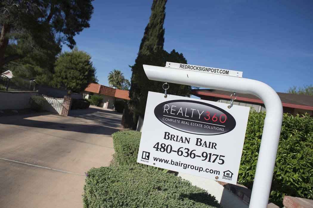"""A """"for sale"""" sign sit out front a home near the intersection of West Washington Avenue and North Valley View Boulevard on Wednesday, May 3, 2017, in Las Vegas. Bridget Bennett/Las Vegas Review-Jou ..."""