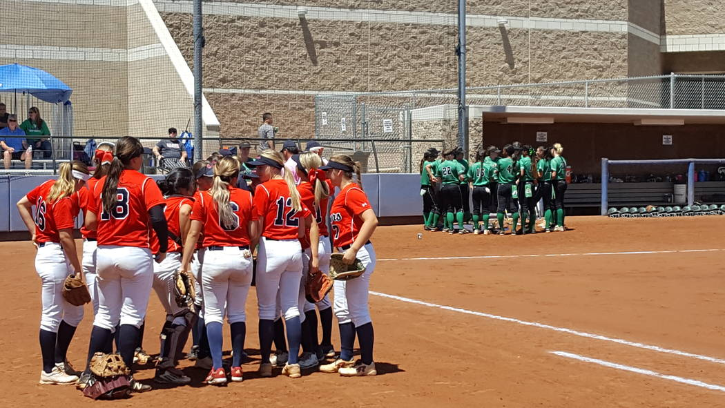 The Coronado, front, and Rancho softball teams prepare for the Class 4A Sunrise Region championship Saturday at Bishop Gorman. (David Schoen/Las Vegas Review-Journal)