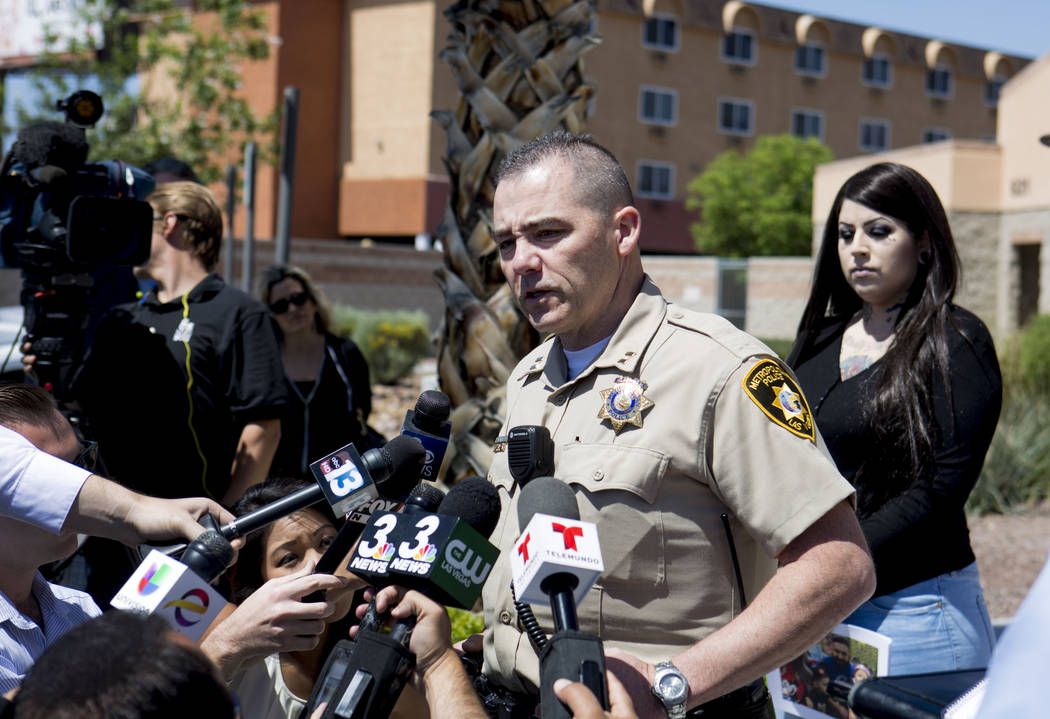 Capt. Andy Walsh discusses the death of 45-year-old Luis Campos during a press conference with the victim's wife, Julie, at the Metropolitan Police Department's downtown area command in Las Vegas, ...