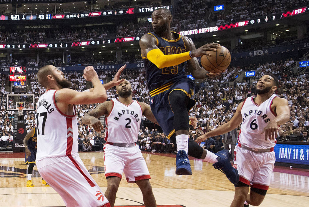 Cleveland Cavaliers forward LeBron James (23) drives to the basket past Toronto Raptors center Jonas Valanciunas (17), Raptors forward PJ Tucker (2) and Raptors guard Cory Joseph (6) during the fi ...