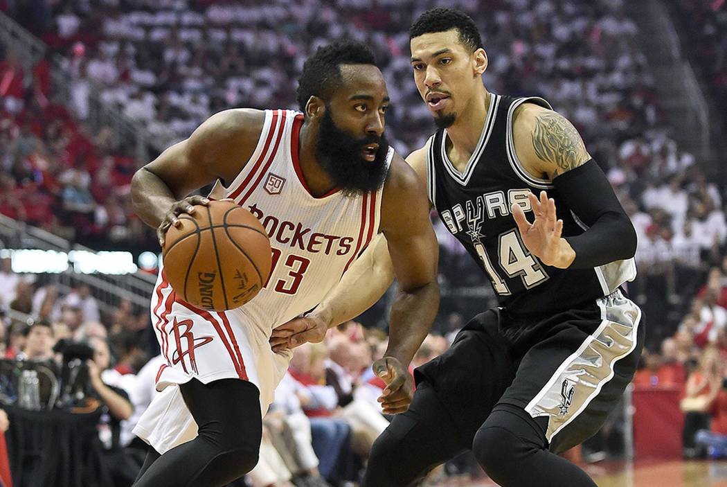 Houston Rockets guard James Harden (13) drives past San Antonio Spurs guard Danny Green (14) during the first half in Game 3 of an NBA basketball second-round playoff series, Friday, May 5, 2017,  ...