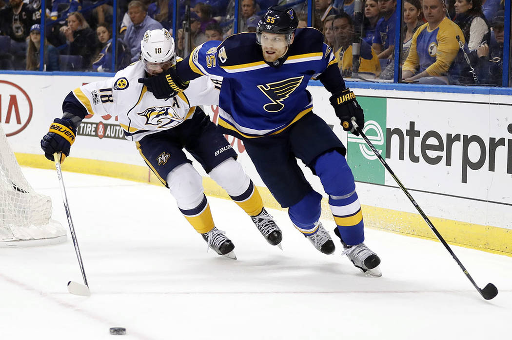 St. Louis Blues defenseman Colton Parayko (55) moves past Nashville Predators right wing James Neal (18) during the third period in Game 5 of an NHL hockey second-round playoff series Friday, May  ...