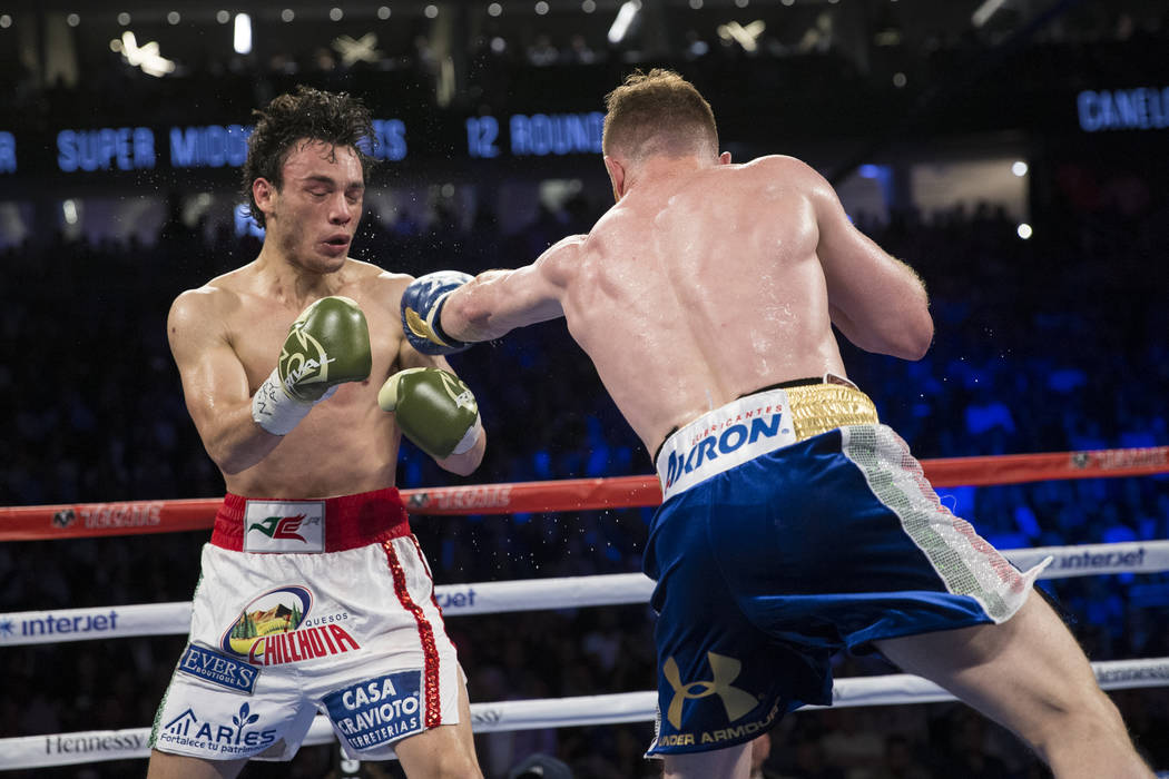 Saul Canelo Alvarez, right, connects a punch against Julio Cesar Chavez Jr. in the catch weight bout at T-Mobile Arena on Saturday, May 6, 2017, in Las Vegas. Alvarez won by unanimous decision. Er ...