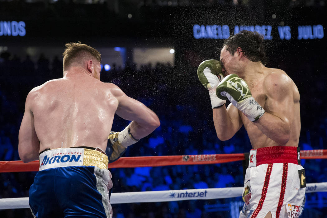 Saul Canelo Alvarez, left, connects a punch against Julio Cesar Chavez Jr. in the catch weight bout at T-Mobile Arena on Saturday, May 6, 2017, in Las Vegas. Alvarez won by unanimous decision. Eri ...