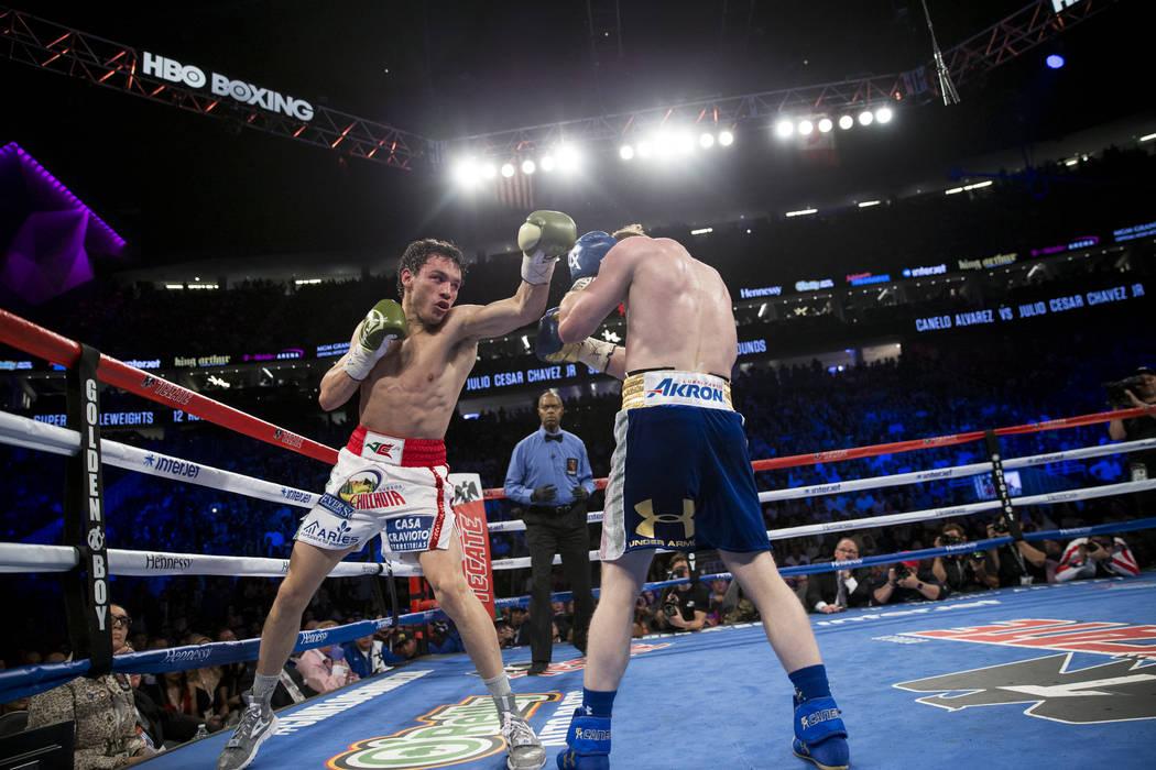 Julio Cesar Chavez Jr., left, battles Saul Canelo Alvarez in the catch weight bout at T-Mobile Arena on Saturday, May 6, 2017, in Las Vegas. Alvarez won by unanimous decision. Erik Verduzco Las Ve ...