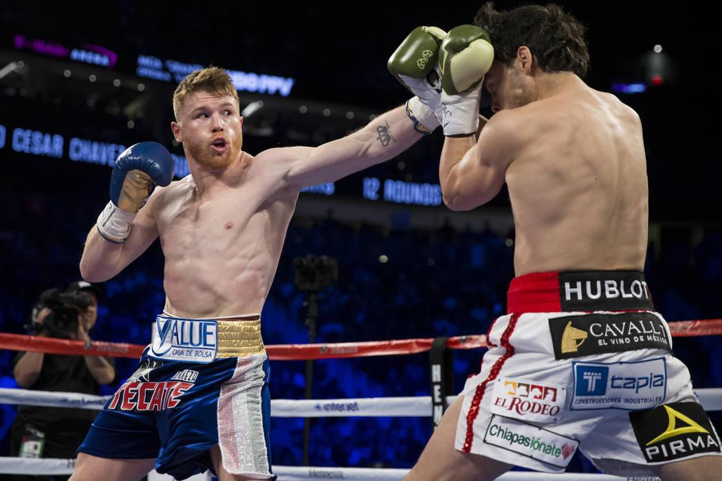 Saul Canelo Alvarez, left, battles Julio Cesar Chavez Jr. in the catch weight bout at T-Mobile Arena on Saturday, May 6, 2017, in Las Vegas. Alvarez won by unanimous decision. Erik Verduzco Las Ve ...