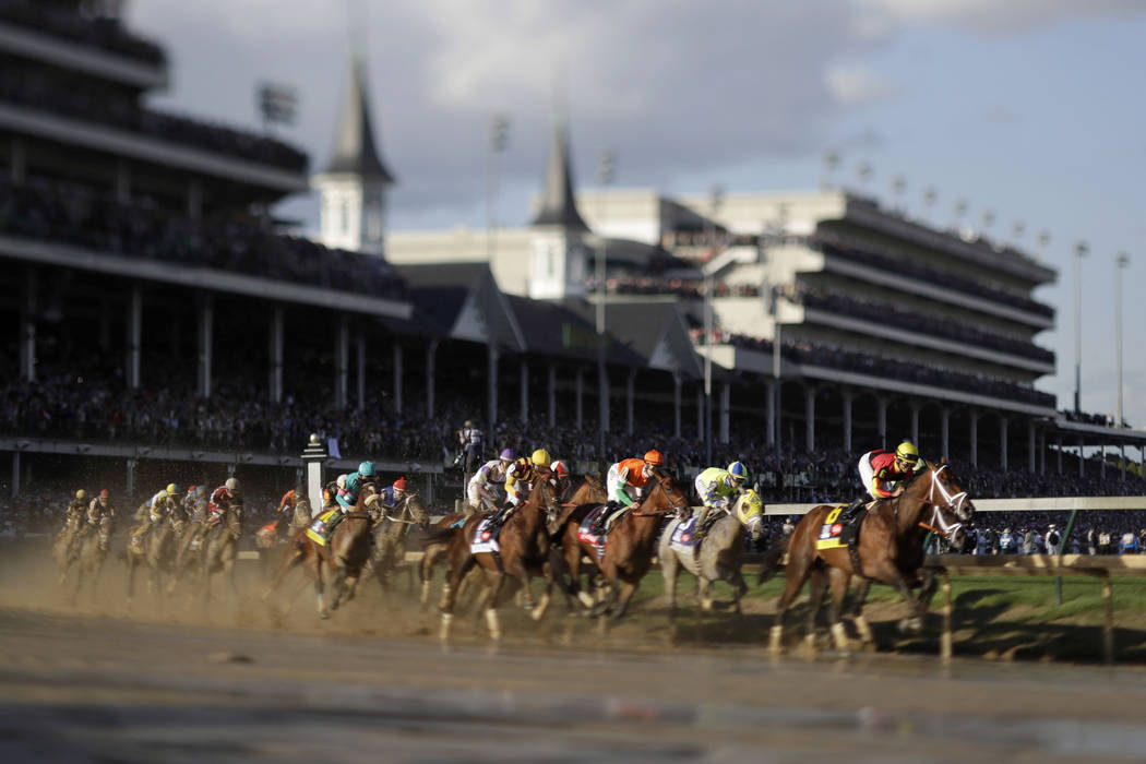 In this image made with a tilt-shift lens, John Velazquez rides Always Dreaming to victory in the 143rd running of the Kentucky Derby horse race at Churchill Downs Saturday, May 6, 2017, in Louisv ...