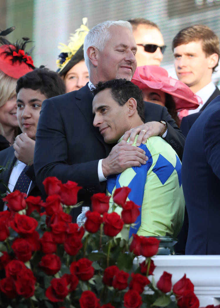 May 6, 2017; Louisville , KY, USA; Horse jockey John Velazquez hugs trainer Todd Pletcher after riding Always Dreaming to victory in the 2017 Kentucky Derby at Churchill Downs. Mandatory Credit: M ...