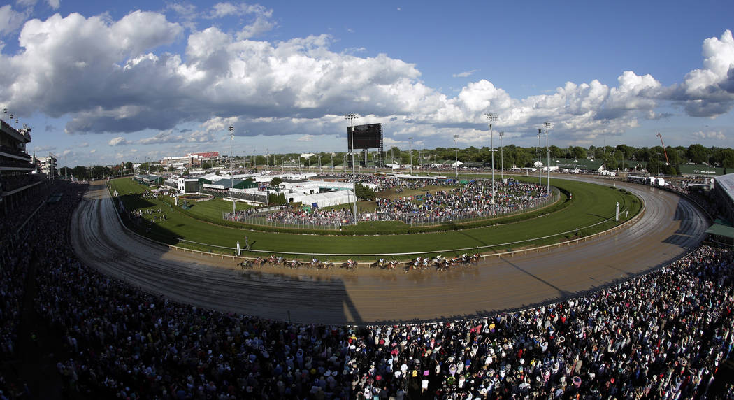 Horses run through the first turn during the 143rd running of the Kentucky Derby horse race at Churchill Downs Saturday, May 6, 2017, in Louisville, Ky. (AP Photo/Charlie Riedel)