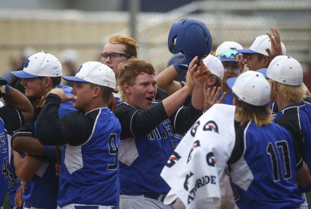 Basic's Jack Wold, center, celebrates with teammates after scoring a run against Silverado during their first playoff game of the season at Basic High School in Henderson on Tuesday, May 9, 2017.  ...