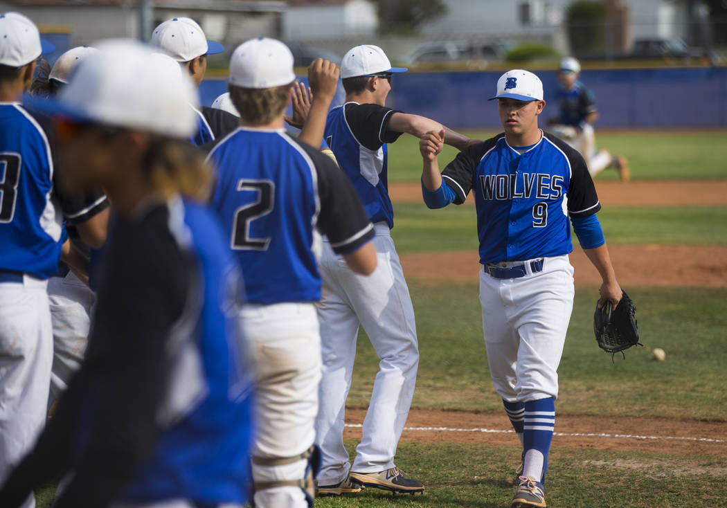 Basic's C.J. Dornak (9), right, high-fives teammates during their first playoff game of the season at Basic High School in Henderson on Tuesday, May 9, 2017. Chase Stevens Las Vegas Review-Journal ...
