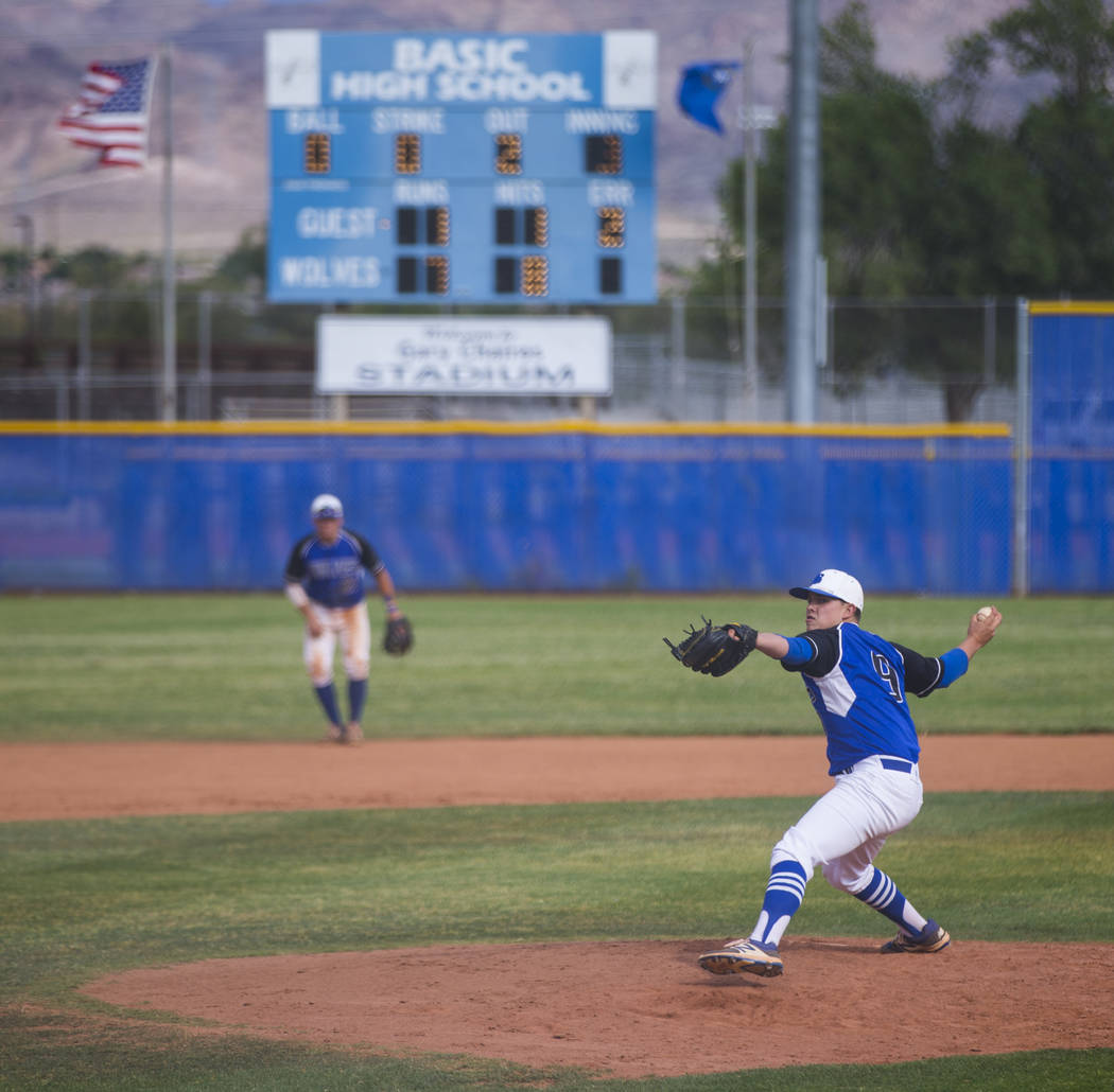 basics cj dornak pitches to silverado during their first playoff game of the season at basic