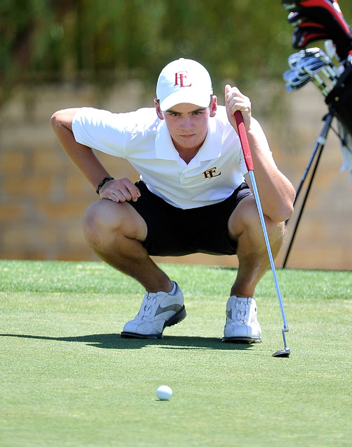 Faith Lutheran's Charlie Magruder lines up his shot on the fifth hole during the final round of the Division I-A Southern Region tournament on Tuesday. Magruder shot 152 to tie for second and help ...