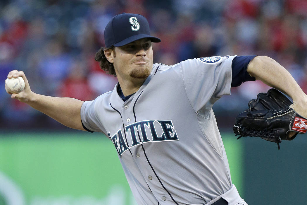 Blake Beavan, shown while with the Seattle Mariners in 2014, gave up 10 runs on 10 hits and five walks over 4 1/3 innings in losing his 51s debut to Albuquerque on Saturday. (AP Photo/LM Otero)