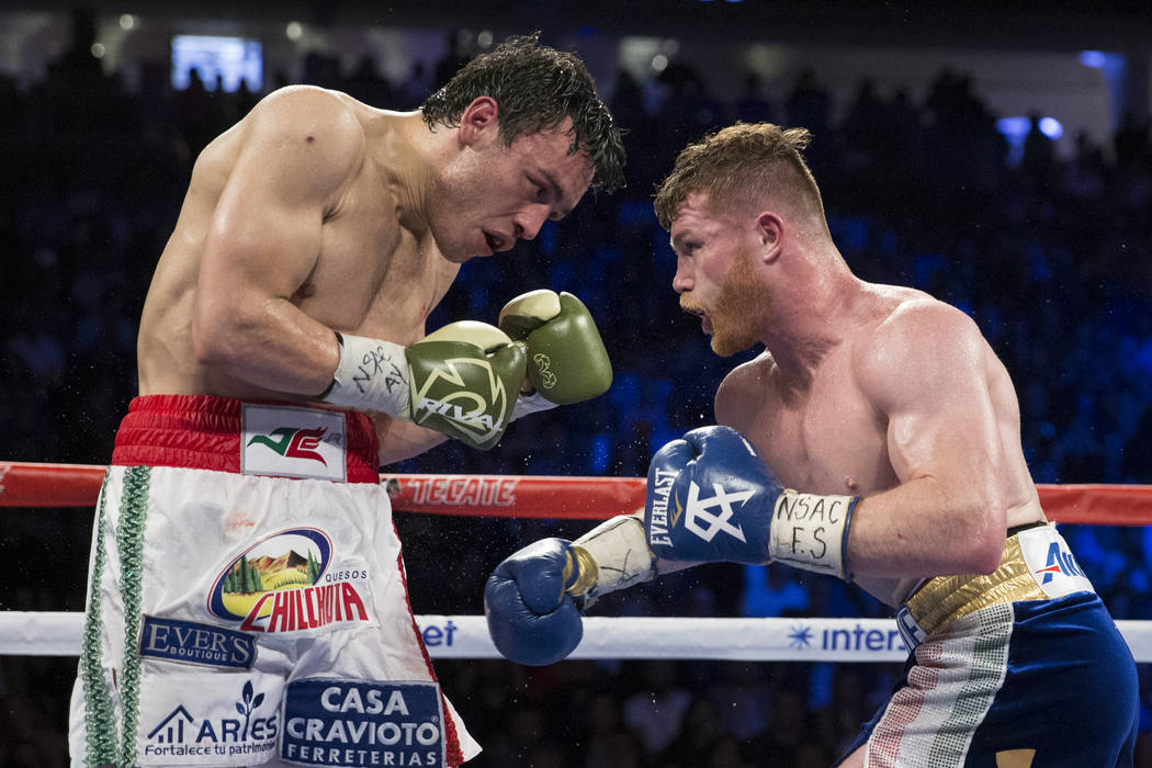 Julio Cesar Chavez Jr., left, battles Saul Canelo Alvarez in the catch weight bout at T-Mobile Arena on Saturday, May 6, 2017, in Las Vegas. Alvarez won by unanimous decision. Erik Verduzco Las Ve ...
