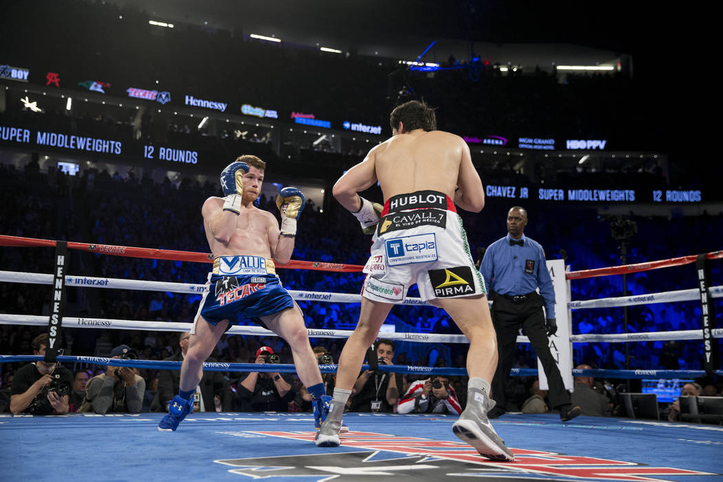 Saul Canelo Alvarez, left, battles Julio Cesar Chavez Jr. in the catch weight bout at T-Mobile Arena on Saturday, May 6, 2017, in Las Vegas. Alvarez won by unanimous decision. Erik Verduzco Las Ve ...