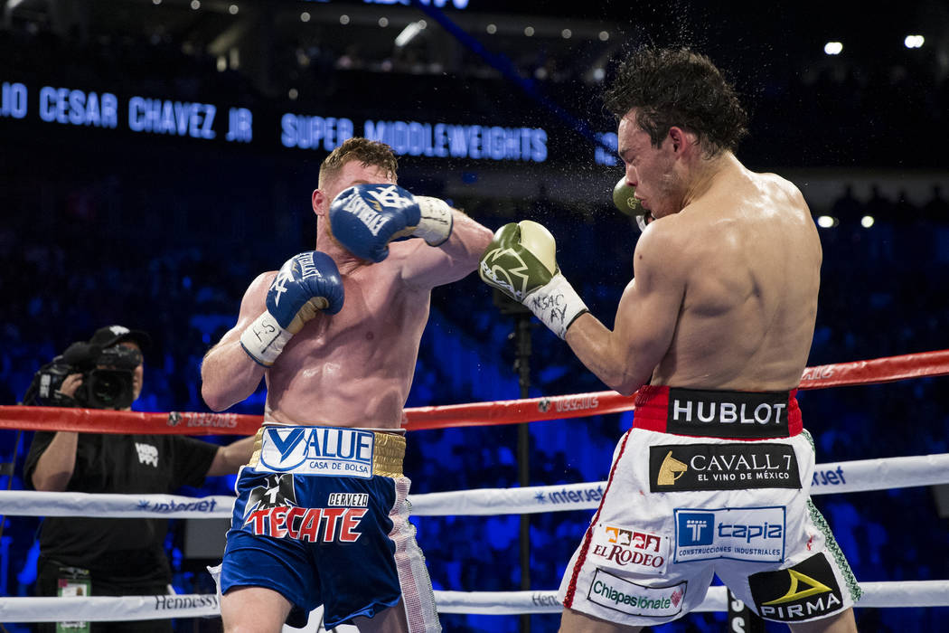 Saul Canelo Alvarez, left, punches Julio Cesar Chavez Jr. in the catch weight bout at T-Mobile Arena on Saturday, May 6, 2017, in Las Vegas. Alvarez won by unanimous decision. Erik Verduzco Las Ve ...