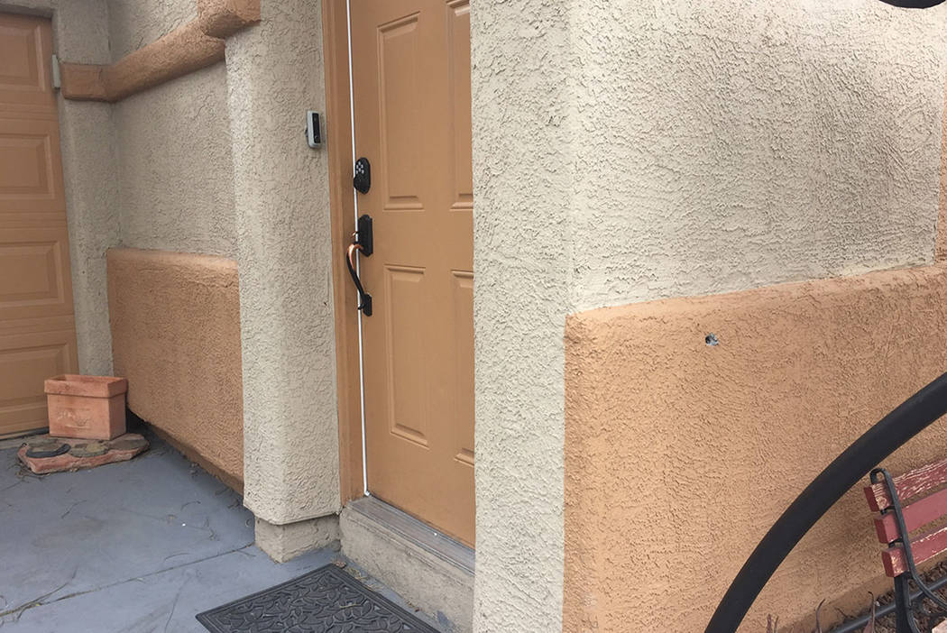 A bullet hole, right, is seen Sunday outside Maria Armendariz's home on Shreve Avenue in Las Vegas. (Blake Apgar/Las Vegas Review-Journal)