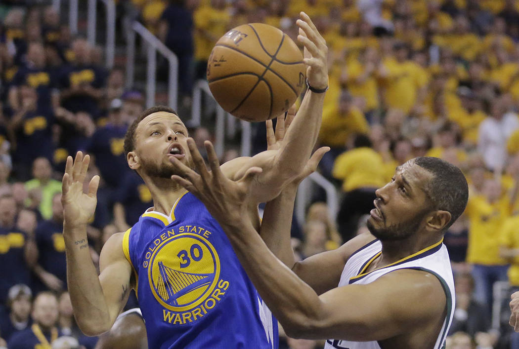 Golden State Warriors guard Stephen Curry (30) and Utah Jazz center Boris Diaw, right, battle for a rebound in the first half during Game 3 of the NBA basketball second-round playoff series Saturd ...