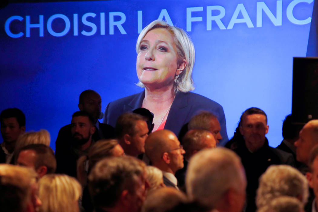 Marine Le Pen, French National Front (FN) political party candidate for French 2017 presidential election, is seen on a screen while conceding defeat at the Chalet du Lac in the Bois de Vincennes  ...