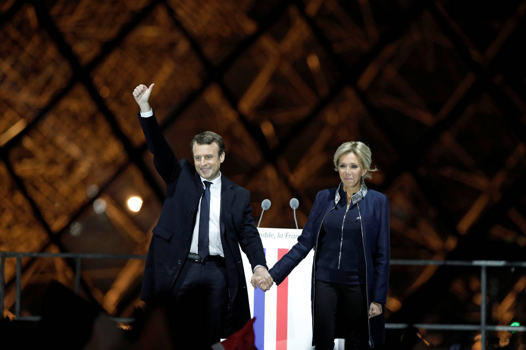 French President elect Emmanuel Macron and his wife Brigitte Trogneux celebrate on the stage at his victory rally near the Louvre in Paris, France May 7, 2017. , France May 7, 2017. REUTERS/Benoit ...
