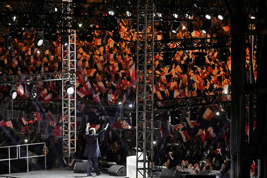 French President-Elect Emmanuel Macron celebrates on stage during his victory rally near the Louvre museum after the results in the second round of the French presidential election, in Paris, Fran ...