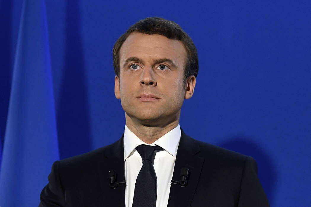Incoming French president Emmanuel Macron prepares to speak after his victory in presidential runoff, at his campaign headquarters in Paris, Sunday, May 7, 2017. French voters elected centrist Emm ...