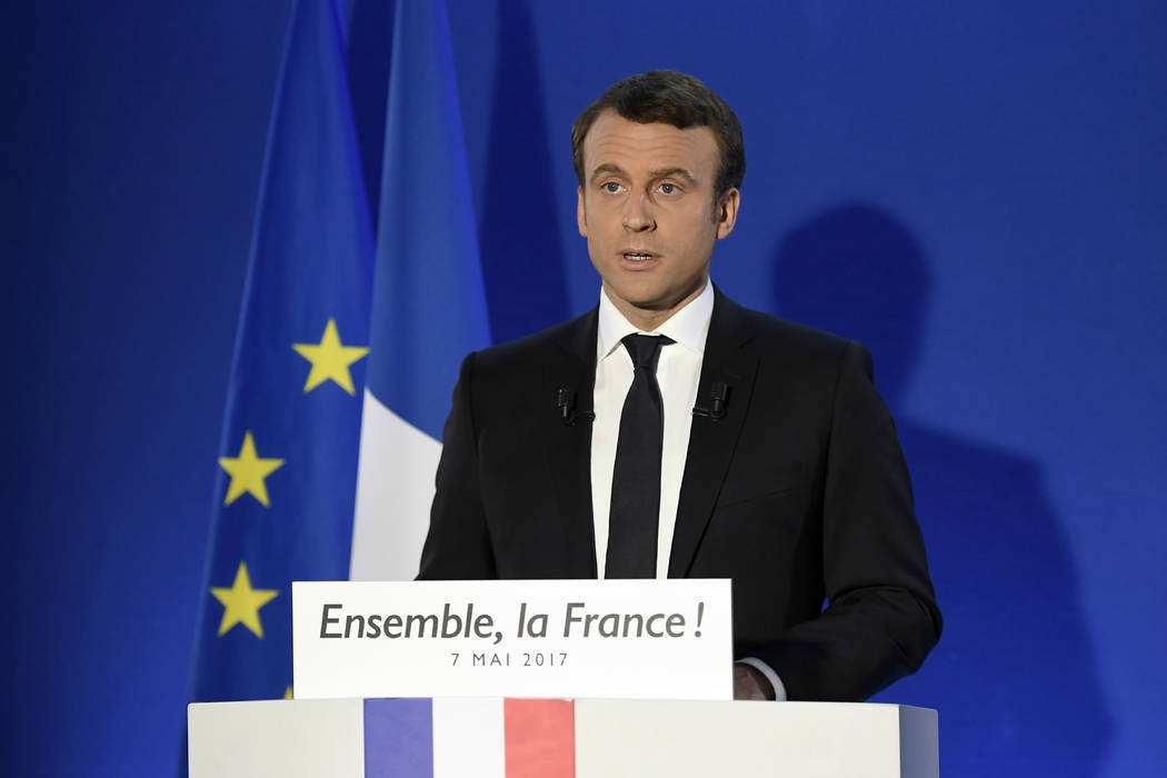 Incoming French president Emmanuel Macron speaks after his victory in presidential runoff, at his campaign headquarters in Paris, Sunday, May 7, 2017. (Lionel Bonaventure/Pool Photo via AP)