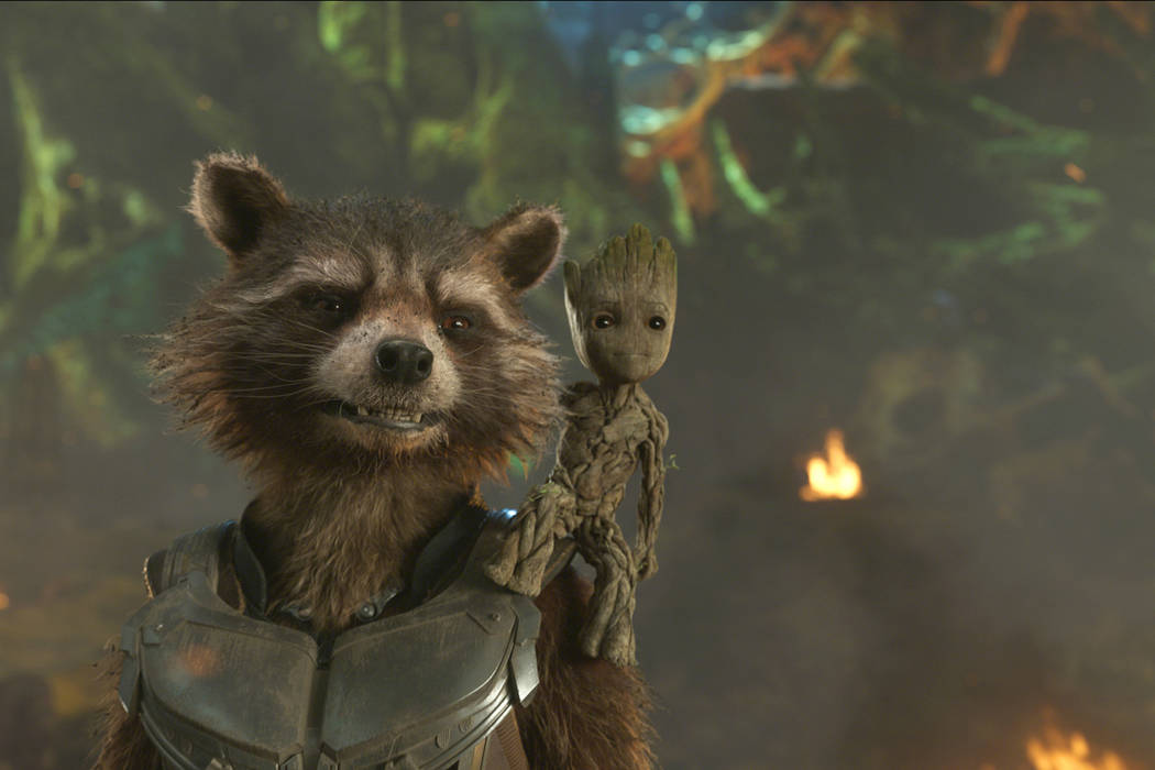 "Rocket, left, voiced by Bradley Cooper, and Groot, voiced by Vin Diesel in a scene from Marvel's ""Guardians Of The Galaxy Vol. 2.""  (Marvel Studios/Disney via AP)"