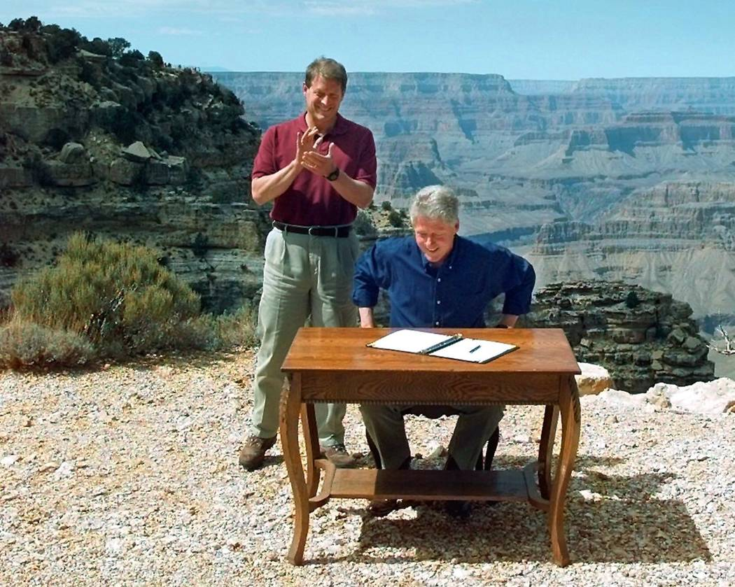 Vice President Al Gore applauds Sept. 18, 1996, after President Bill Clinton signs a bill designating about 1.7 million acres of land in southern Utah's red-rock cliff as the Grand Staircase-Escal ...