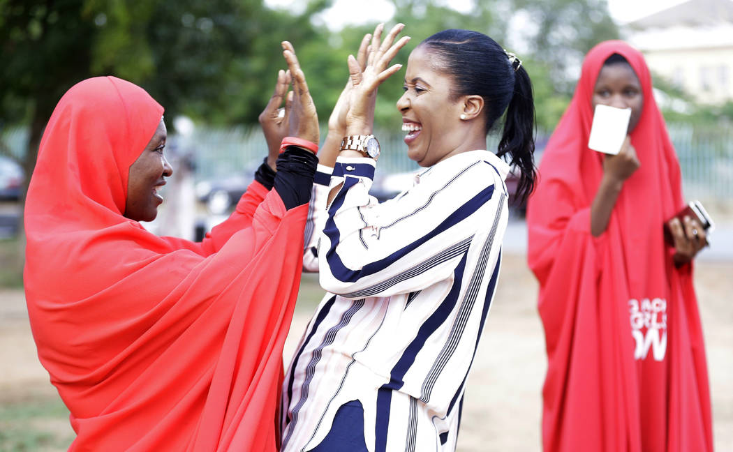 'Bring Back Our Girls' campaigners celebrate the release of the kidnapped Chibok school girls at the unity fountain in Abuja, Nigeria, Sunday, May. 7, 2017.  Five Boko Haram commanders were releas ...