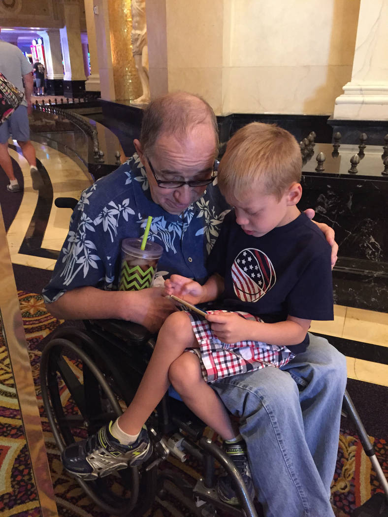 Robert Brewer, left, is seen with his grandson, Jacob. (Kate Gringas)