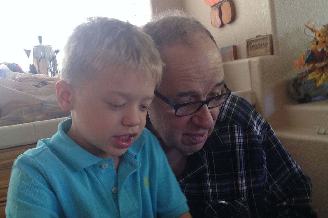Robert Brewer, right, is seen with his grandson, Jacob. (Kate Gringas)