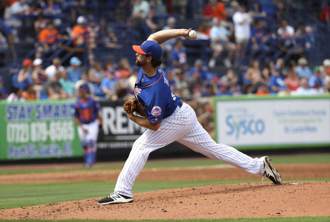 New York Mets pitcher Logan Taylor throws against the Washington Nationals during a spring training baseball game Saturday, Feb. 25, 2017, in Port St. Lucie, Fla. (AP Photo/David J. Phillip)