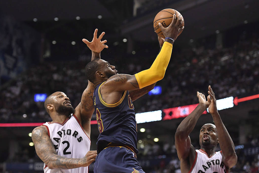Cleveland Cavaliers forward LeBron James (23) goes to the net past Toronto Raptors forwards P.J. Tucker (2) and Serge Ibaka (9) during the second half of Game 4 of a second-round NBA basketball pl ...