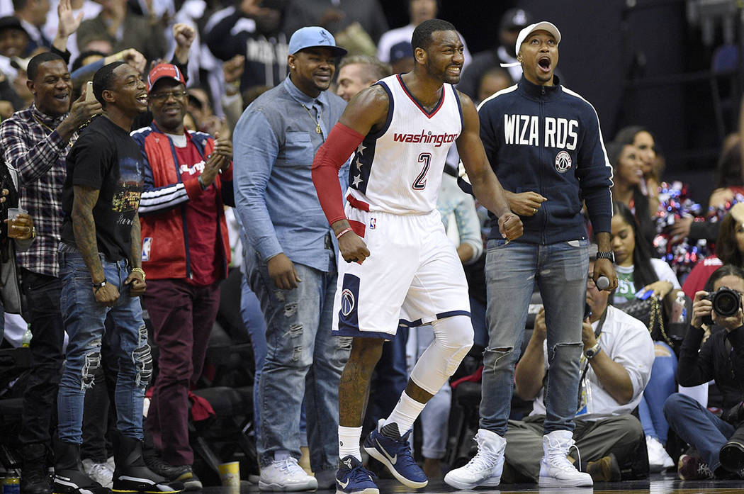 Washington Wizards guard John Wall (2) reacts during the second half in Game 4 of a second-round NBA basketball playoff series against the Boston Celtics, Sunday, May 7, 2017, in Washington. (AP P ...
