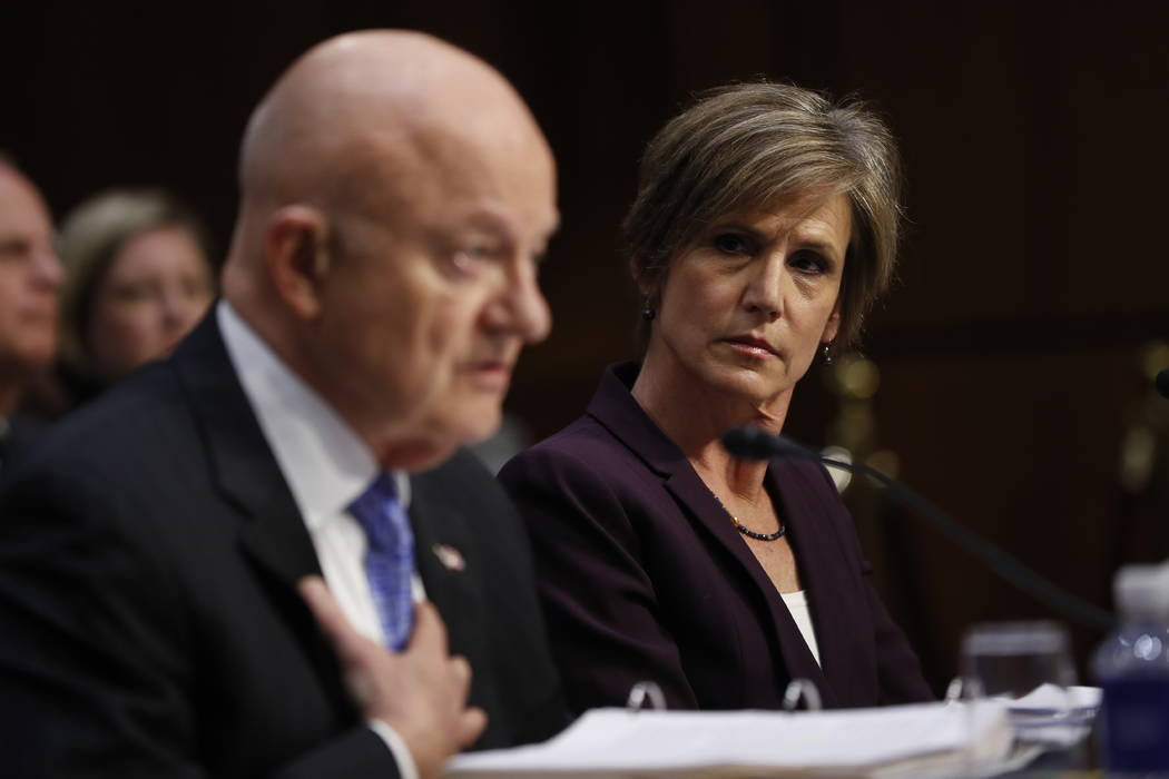 Former acting Attorney General Sally Yates listens at right as former National Intelligence Director James Clapper testifies on Capitol Hill in Washington, Monday, May 8, 2017, before the Senate J ...