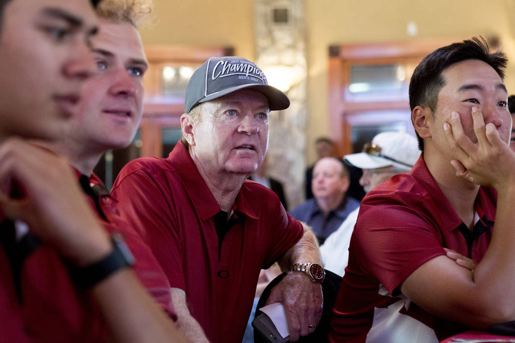 UNLV men's golf head choach Dwaine Knight, center, waits with his team to hear where they will be selected to play for regionals at the Las Vegas Country Club in Las Vegas, Thursday, May 4, 2017.  ...