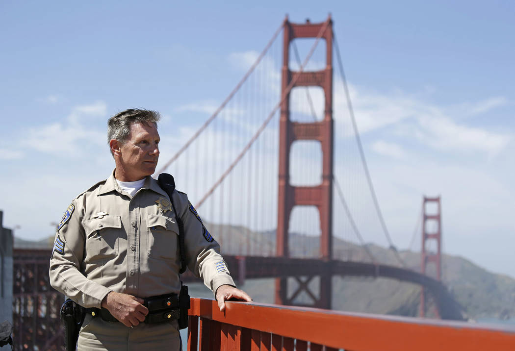 California Highway Patrol Sergeant Kevin Briggs by the Golden Gate Bridge in San Francisco, April 30, 2013. When someone puts one leg over the railing of the Golden Gate Bridge and contemplates pl ...