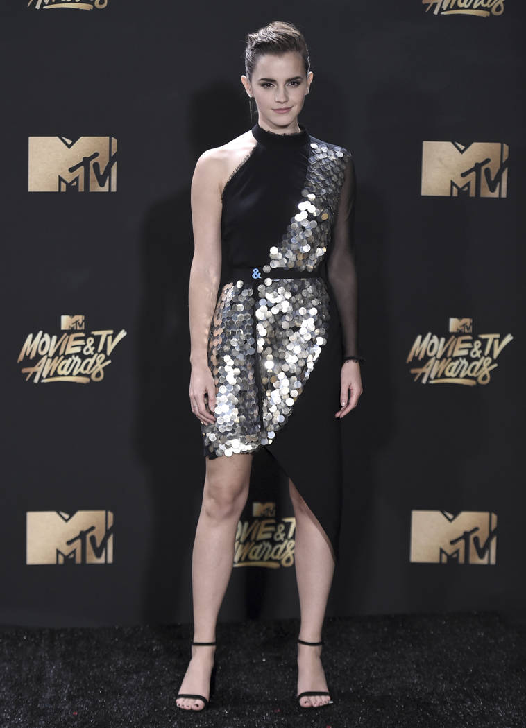 "Emma Watson poses in the press room after winning the award for best actor in a movie for ""Beauty and the Beast"" at the MTV Movie and TV Awards at the Shrine Auditorium on Sunday, May 7, 2017, in  ..."