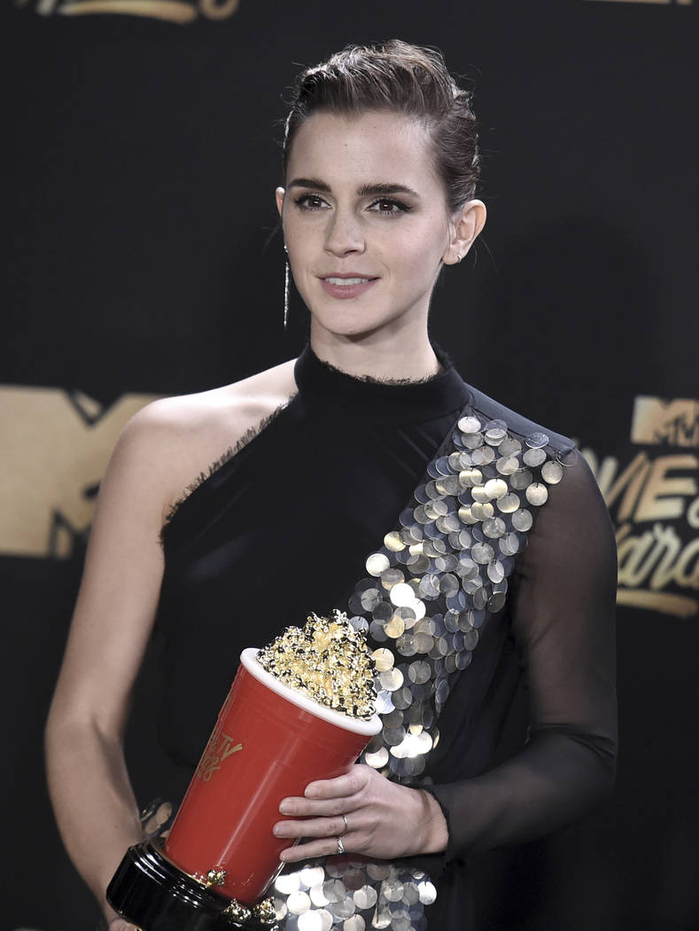 "Emma Watson poses in the press room with the award for best actor in a movie for ""Beauty and the Beast"" at the MTV Movie and TV Awards at the Shrine Auditorium on Sunday, May 7, 2017, in Los Angel ..."