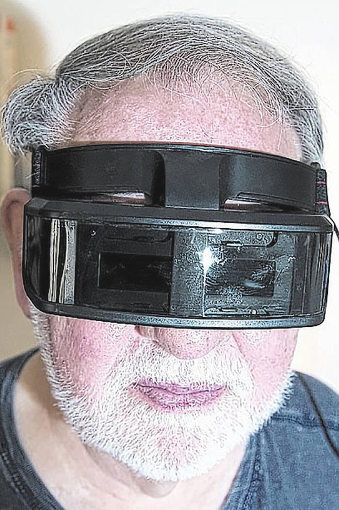 Forrest Nettles wears an Amiga VR (virtual reality) headset that dates to the 1980s.