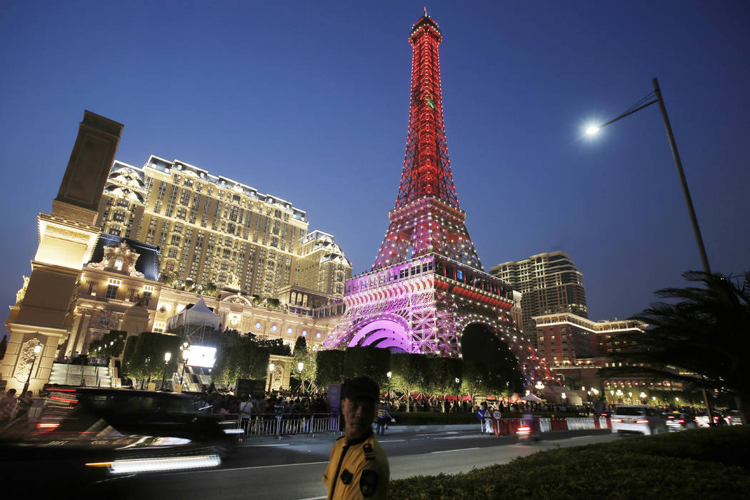 A security guard stands in front of a replica of the Eiffel Tower at Parisian Macao in Macau, China, Sept. 13, 2016. Macau is stepping up security checks at ATMs in the Asian gambling hub by requi ...