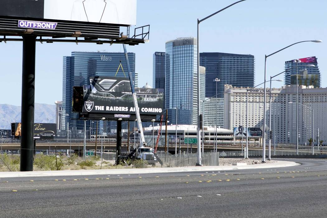 A Raiders billboard stands at the northeast corner of Dean Martin Drive near Hacienda Avenue at the team's Russell Road stadium site in Las Vegas. (Heidi Fang/Las Vegas Review-Journal) @HeidiFang