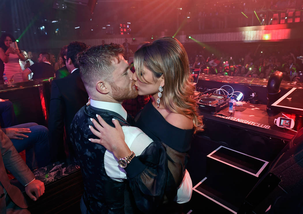 Canelo Alvarez and Fernanda Gomez celebrate during his Official After-Fight Party at Jewel at Aria on Saturday, May 6, 2017, in Las Vegas. (David Becker/WireImage)