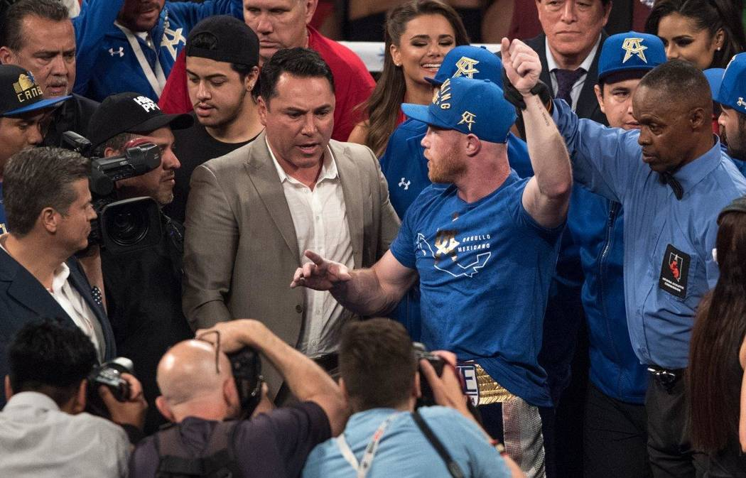 "Saul ""Canelo"" Alvarez, pictured here, with Oscar De La Hoya, and Julio Cesar Chavez Jr. fight at T-Mobile Arena on Saturday, May 6, 2017, in Las Vegas. Alvarez won in a unanimous decision after 12 ..."