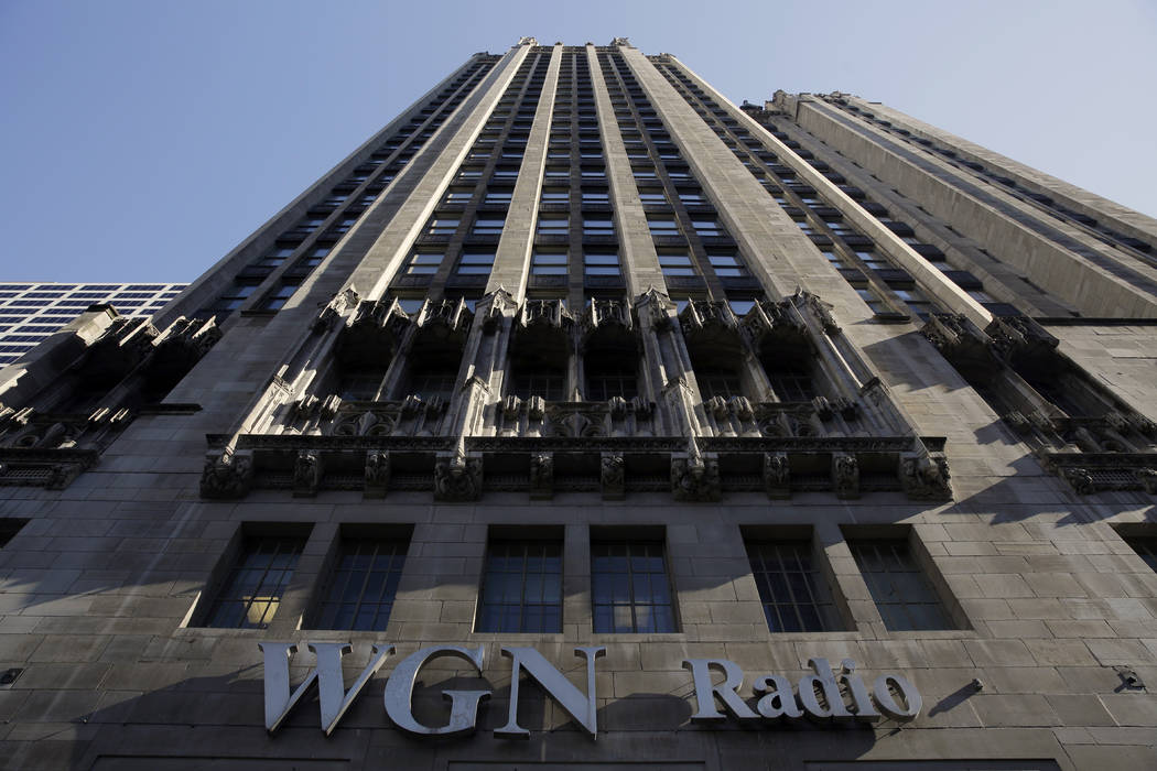 The WGN Radio sign on the side of Tribune Tower, in downtown Chicago, May 1, 2017. Sinclair Broadcast Group, one of the nation's largest local TV station operators, announced Monday, May 8, 2017,  ...