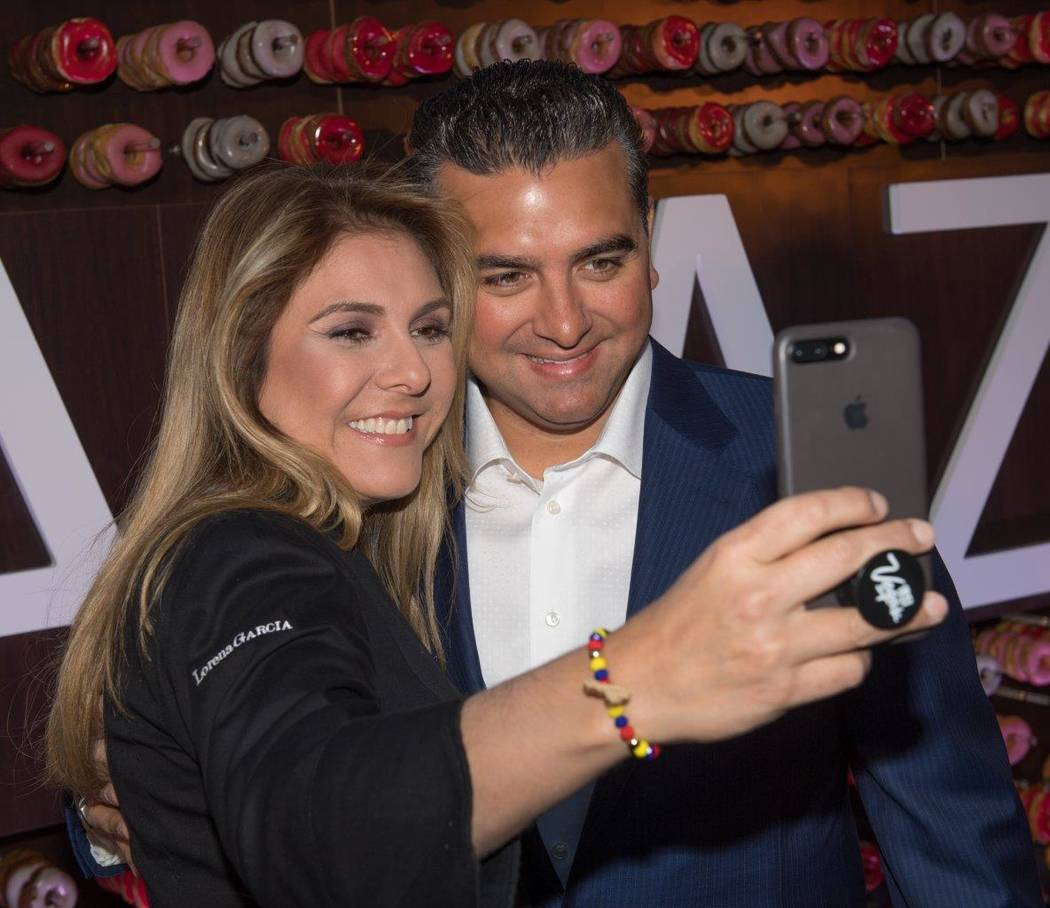 """Sweet Escape: An Evening of Buddy, Beignets, Bonbons & Booze"" hosted by Buddy Valastro, pictured here with Lorena Garcia, at The Aquatic Club at The Palazzo for Vegas Uncork'd on Saturday ..."