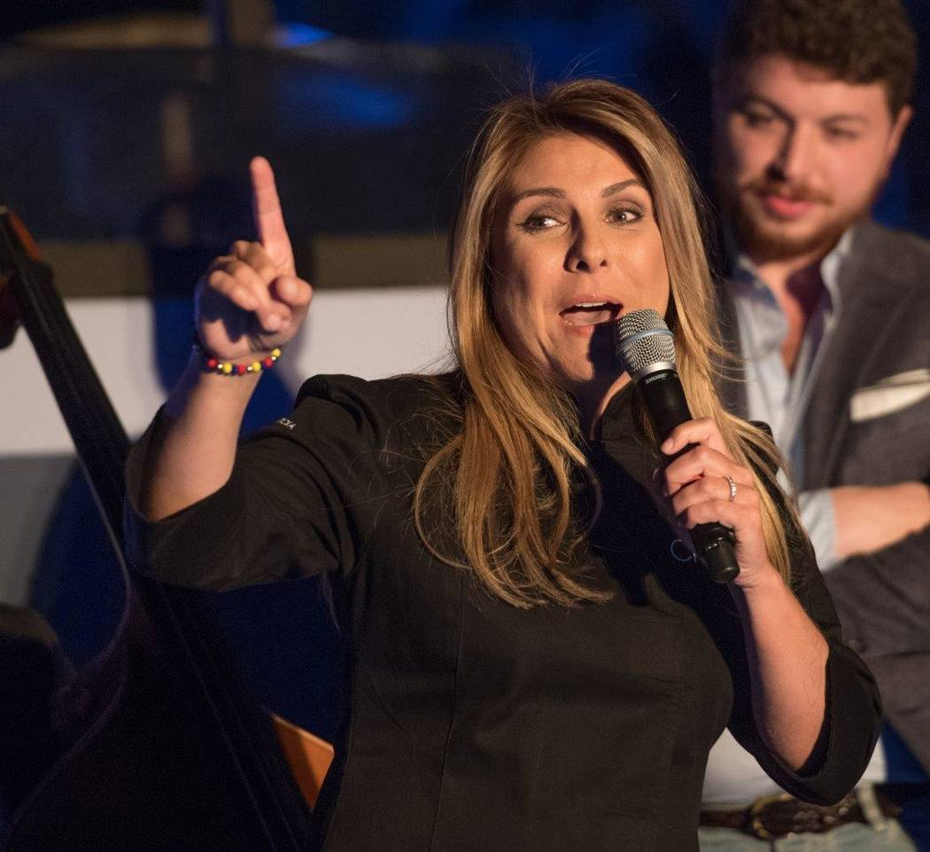 "Lorena Garcia addresses the crowd during ""Sweet Escape: An Evening of Buddy, Beignets, Bonbons & Booze"" hosted by Buddy Valastro at The Aquatic Club at The Palazzo for Vegas Uncork'd on Sa ..."