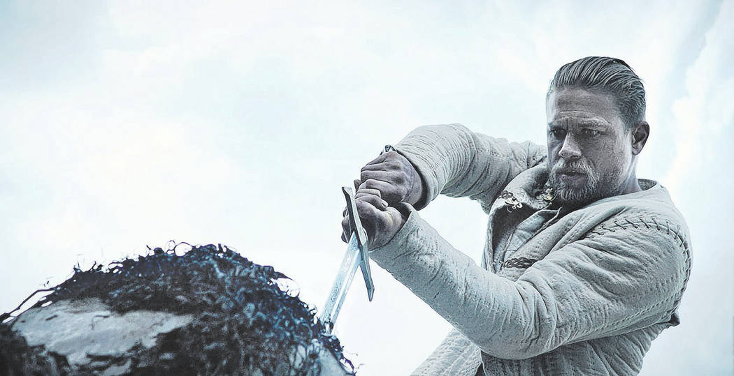 """Photo Credit: Courtesy of Warner Bros. Pictures  Caption: CHARLIE HUNNAM as Arthur in Warner Bros. Pictures' and Village Roadshow Pictures' fantasy action adventure """"KING ARTHUR: LEGEND O ..."""